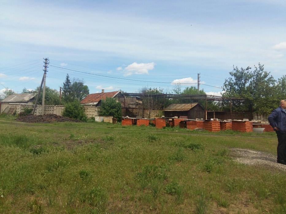 Продам землю с постройками